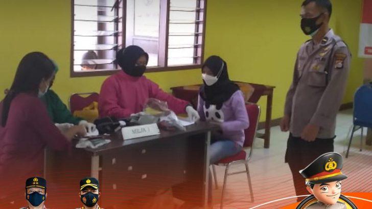 Wujudkan Herd Immunity, Polresta Tangerang Kawal Pelaksanaan Vaksinasi di Mauk
