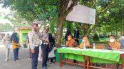 Personel Satlantas Polresta Tangerang Imbau Masyarakat Cegah Penyebaran Covid-19 Dengan Vaksin